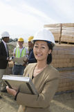 Female Engineer Holding Clipboard At Site Royalty Free Stock Photos