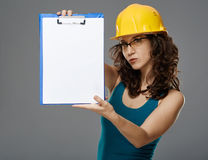 Female engineer holding a folder with copyspace Stock Images