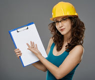 Female engineer holding a folder with copyspace Royalty Free Stock Photos
