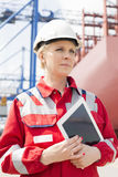 Female engineer holding tablet computer in shipping yard Stock Image