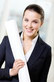 Female engineer with layout Royalty Free Stock Photography