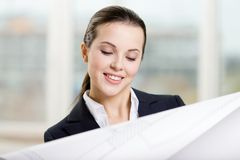 Female engineer looks through the blueprint Stock Image