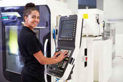Female Engineer Operating CNC Machinery On Factory Floor Stock Photos