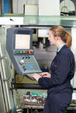 Female Engineer Operating Computer Controlled Cutting Machine Royalty Free Stock Image