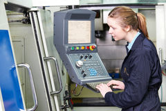Female Engineer Operating Computerized Cutting Machine. Female Engineer Operates Computerized Cutting Machine stock images