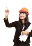 Female engineer with a pen writing Royalty Free Stock Image