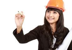Female engineer with a pen writing Stock Photography