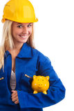Female engineer with piggy bank Stock Images