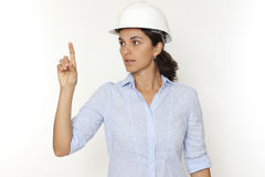 Female engineer pointing on virtual screen Stock Image