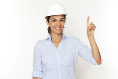 Female engineer pointing on virtual screen Stock Photo