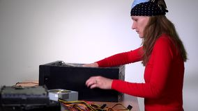 Female engineer remove computer motherboard stock video footage