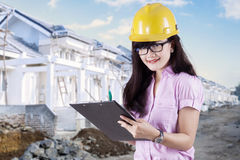 Female engineer in the residential site Royalty Free Stock Photo
