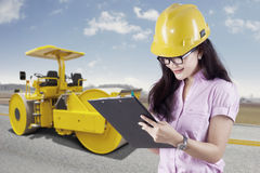 Female engineer and road roller Stock Images