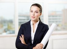 Female engineer with sketch. Female engineer wearing suit hands sketch Royalty Free Stock Images