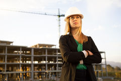 Female Engineer Standing in Front of Construction Stock Photo