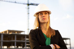 Female Engineer Standing in Front of Construction Royalty Free Stock Image