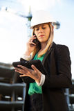 Female Engineer Talking on Phone With iPad Standing in Front of Royalty Free Stock Photography