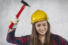 Female engineer is testing the strength of a helmet Royalty Free Stock Photo