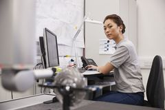 Female Engineer Uses CMM Coordinate Measuring Machine In Factory royalty free stock image