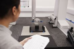 Female Engineer Uses CMM Coordinate Measuring Machine In Factory royalty free stock images