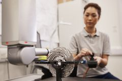 Female Engineer Uses CMM Coordinate Measuring Machine In Factory royalty free stock photography