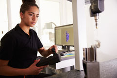 Female Engineer Using CAD System To Work On Component Royalty Free Stock Photography