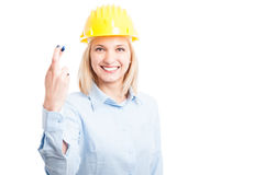 Female engineer wearing helmet showing fingers crossed Stock Images