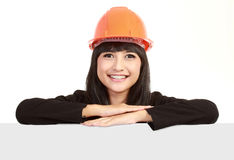 Female engineer and white card Royalty Free Stock Images