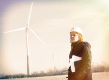 Female engineer with wind turbines Royalty Free Stock Photos