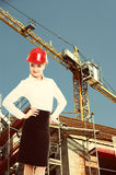 Female engineer woman in red safety helmet on construction site Royalty Free Stock Photos