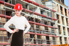 Female engineer woman in red safety helmet on construction site Stock Photography
