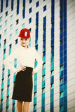 Female engineer woman in red safety helmet and modern building Stock Image