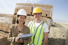 Female Engineer With Worker At Site Royalty Free Stock Images