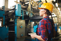 Female Engineer Wrapped up in Work royalty free stock photos