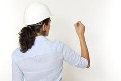 Female engineer writing Royalty Free Stock Photo