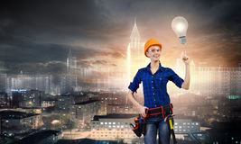 Female engineer. Young pretty woman engineer with tool belt on waist Stock Photography