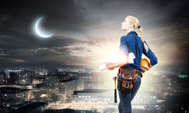Female engineer. Young pretty woman engineer with tool belt on waist Royalty Free Stock Photo