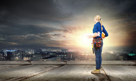 Female engineer. Young pretty woman engineer with tool belt on waist Royalty Free Stock Photos