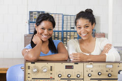 Female engineering students at test bench Stock Photography