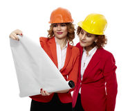 Female engineers in hardhats looking over project Royalty Free Stock Images