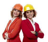 Female engineers in hardhats on white Stock Image