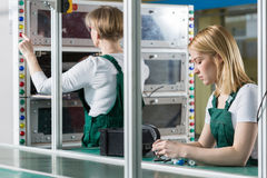 Female engineers working in factory Stock Photo