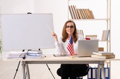 The female english teacher in the classroom. Female english teacher in the classroom royalty free stock photography
