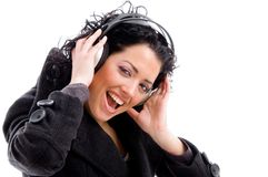 Female enjoying music with headphones. On an isolated background Royalty Free Stock Photo