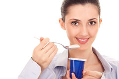 Female enjoying taste of yogurt. Isolated on white, close up Royalty Free Stock Photo