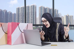 Female entrepreneur angry after shopping online Royalty Free Stock Photo