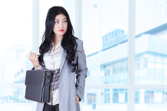 Female entrepreneur with briefcase Stock Photo