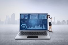 Female entrepreneur and business graph Stock Photos