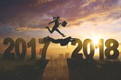 Business people with numbers 2017 and 2018 Stock Photos