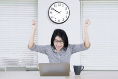Female entrepreneur celebrating her success on office Royalty Free Stock Image